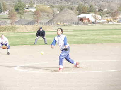 by: Photo By Brian Liebenstein - Verna Mitchell pitches for the Madras softball White Buffalos in their ill fated Friday game against Sweet Home. A four-run inning let Sweet Home pull out a 7-5 win.