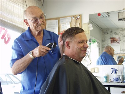 by: Pioneer file photo - Ernie Walston cuts hair at City Barber Shop in 2004.