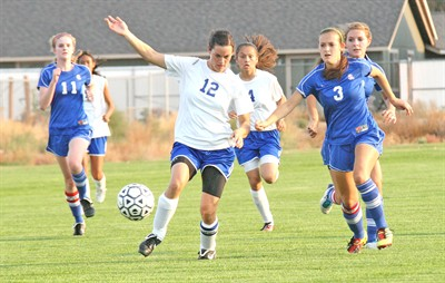 by: Photo by Joe McHaney - Madras senior Kristin Jasa competes for the ball Sept. 22 against visiting La Salle.