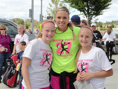 by: Submitted photo - Kira Thomas (left) and Leah Buck (right) of Madras recently met Jennie Finch (middle) at the Jennie Finch softball camp in Medford.