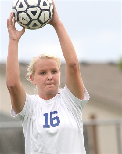 by: Photo By Joe McHaney - Madras senior Megan Boyle tosses a soccer ball into play Oct. 4 against visiting Molalla.
