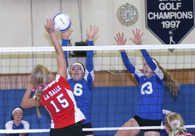 by: Photo By Joe McHaney - Madras' Cheyenne Parsons (6) and Laura Sullivan (13) attempt to block a kill  by La Salle's Ximena Giesemann Oct. 10 during a Class 4A Tri-Valley Conference volleyball match at Madras High School.