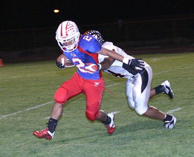 by: Photo By Joe McHaney - Madras running back Joe Hisatake fights for yards Oct. 7 against visiting Gladstone during a Class 4A Tri-Valley Conference football game.