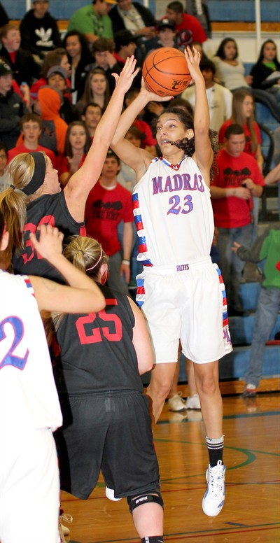by: Photo By Joe McHaney - Abby Scott of Madras shoots a jump shot against visiting Mazama Dec. 9.