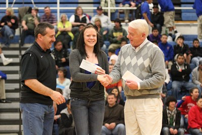by: Photo by Joe McHaney - Dick Anderson, right, general manager of Miller Ford in Madras, presented the Drive One 4 UR School check for $2,640 to Madras High School student body president Shani Rehwinkel, center, and athletic director Paul Brown, left, at the Dec. 13 home boys basketball game. The money will go toward school activities.