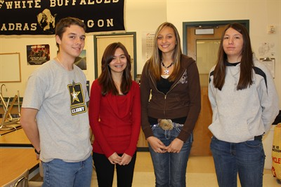 by: Photo by Susan Matheny - Precision shooters Devin McLean, left, Ayzia Sherer, Alexis Urbach and Andrea Guerin are raising funds to attend the Army JROTC championship contest in Ohio.