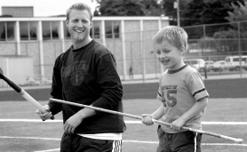 by: David Ball, Scott Halley, a 1997 Gresham High School graduate, tosses around a javelin with his 3-year-old son, Ethan, last week. Scott qualified for the USA Track and Field Championships this weekend in Indianapolis.