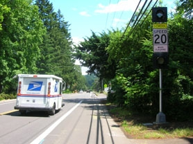 by: Cori Bolger, A newly installed sign and flashing light on Jean Road warns drivers to obey school zone laws outside of Waluga Junior High and Bryant Elementary schools. The sign is one of several installed by the city of Lake Oswego to improve pedestrian safety around