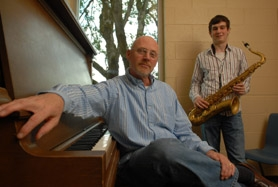 by: Vern Uyetake, Jeff Cumpston sits at the piano inside a practice room in the WLHS music building, after listening to the improvised jazz that emanates from the mind and heart of Presidential Scholar Matt Rognlie, who named Cumpston his most inspirational teacher.