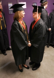 by: Jaime Valdez, Hanna Lindquist and her older brother Andrew, share a moment before Beaverton High School's graduation. Andrew, who has Down syndrome, graduated with his sister.