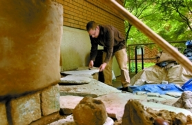 by: Jim Clark, Pedro Ferbel-Azcarate, a Portland State University professor, selects stones for a cob bench that was constructed at PSU as part of City Repair Project's recent Village Building Convergence. A reader praises the group's efforts in making places where people can connect.