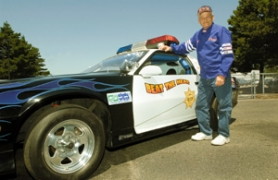by: John Klicker, Gresham resident Jim Klock and two police officers