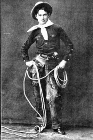 by: , An early photo of Will Rogers, in costume and on stage, in vaudeville. Photo courtesy of www.wikipedia.org.