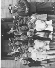 by: Contributed photo, The congregation of Sandy Baptist Chapel gathers outside their original Pioneer Boulevard church building to pose for a picture shortly after the chapel's founding in the late 1940s. The Sandy Senior Center now sits where the church once was.