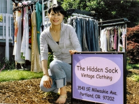 "by: Rita A. Leonard, At ""The Hidden Sock"" in Brooklyn, owner Liu ""Jenny"" Chin displays some of the vintage clothing she offers for sale."