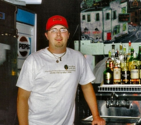 by: Rita A. Leonard, Ryan Dewey, bourbon expert at the new Brooklyn Park Pub, shares ownership and bartending duties with his brother, Nathan, who is the beer expert.