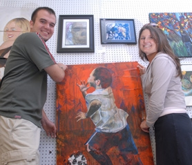 by: Staff Photo / Vern Uyetake, Lake Oswego High School graduate Joe Robinson, left, and LOHS art teacher Katie Erb organized and produced the high school art exhibit at the Lake Oswego Festival of the Arts, held June 23-25. Robinson and Erb also entered their own artwork in the show.