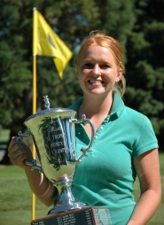 by: Eric Yaillen, Tracy Broders, a Tigard High School graduate, holds the trophy she earned by winning the 2006 Women's Oregon Amateur title.