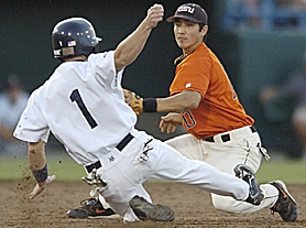 by: CHRIS MACHIAN, MAKING THE TAG — Southridge High graduate Darwin Barney, here tagging out Rice's Derek Myers on June 22 in the semifinals of the College Baseball World Series, helped lift Oregon State to its first-ever national title.