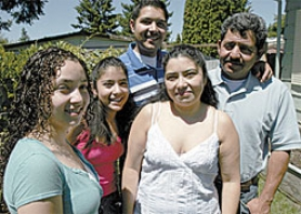 by: Jonathan House, The Diaz family, from left, is Monica, Jennifer, Luis Jr., Irma and Luis Sr.