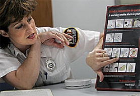 by: Jaime Valdez, Deputy Fire Marshal Kate Stoller explains the use of pictorials on educational materials that depict the importance of working smoke alarms.