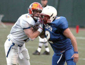 by: Bill Wilson, Recent Sandy graduate Jordan Paola sheds a blocker during the North's 49-25 win in the Les Schwab Oregon Bowl all-star game at PGE Park. Paola forced a fumble in the game.