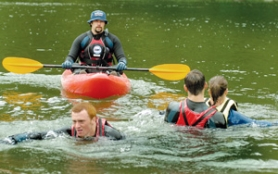 by: Carole Archer, River Rescue Technician Scott Campbell supervises while Center for Advanced Learning students, from left to right, Kyle Seymour, Ben Waldo and Kelsey Hinds complete a two-person contact rescue in the Sandy River during a rescue demonstration Wednesday, May 24, at Glenn Otto Community Park in Troutdale. River Rescue Technicians with American Medical Response monitor the beaches at Glenn Otto and High Rocks Park in Clackamas County from Memorial Day through Labor Day each year. For nearly 30 years, these popular swimming holes were notorious for the number of drownings that occurred there each summer. There have been no drownings at Glenn Otto since AMR's river rescue program was implemented in 1999. The program was made possible in part by support from the Troutdale Booster Club.