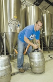by: John Klicker, When Jeremy Carlson, above and right, was a home brewer, he could only dream of having a brewery such as the one pictured here. Now, he's surrounded by kegs, mash tuns and fermenters at his Sandy brewery, Karlsson Brewing.