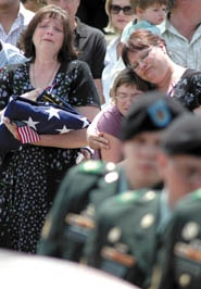 by: photo by Patrick Sherman, Robert Jones' mother looks on while soldiers bear his coffin away
