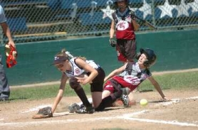 by: DAN BROOD, SHE'S SAFE — Tualatin City's Britta Hall (right) slides safely for a run before Tigard's Shayna Curtis can grab the ball in Saturday's game at the District 4 ages 9-10 softball tournament at Alpenrose Dairy.