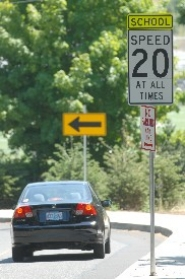 by: Vern Uyetake, A vehicle descends on Skyline Drive near West Linn High School last week, slowing to 20 mph, as the sign orders. But a revised regulation that went into effect last Saturday, among other details, requires slowing to 20 mph only on school days from 7 a.m. to 5 p.m.