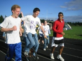 "by: CHRISTIANA CHA, Members of Jenni's West Linn Relay For Life team take the second lap at the Rosemont Ridge Middle School field June 16. From left to right: William Farnbach, Owen Retzlaff (on the unicycle) and Sambaran Chatterjee. In the background are Elizabeth Farrell and Jenni. The teens' team name was ""The One Team ... To Rule Them All,"" and they raised more than $1,000."