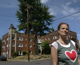 by: Jim Clark, As part of a condominium conversion project, the developer wants to cut down a deodar cedar tree outside the historic Lindquist Apartment House in Northeast Portland. Neighbors, including Alyson Ayn Osborn want the tree – which the firm has since pruned – to stay.