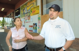 by: John Klicker, Mila Villavicencio, owner of Mila's Hair Salon, left, listens as her business neighbor, Mauricio Alvarez, tells his side of a saga that threatens to pit Rockwood business owners against the city's Redevelopment Commission.