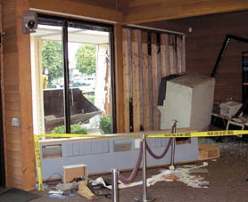by: photo courtesy Clackamas Community Credit Union, The attempt to steal the ATM with a front-end loader just ended up pushing it further into the smashed lobby.