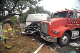 by: Vern Uyetake, Four people were injured Wednesday morning at the intersection of Southwest Mountain and Stafford roads as tanker truck, RV collide.