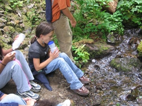 by: MARK SILVERMAN, Aubry Smithson, 9, takes a rest and a drink on the Wahkeena Falls trail in the Columbia Gorge last week. She and fellow Willamette Primary students participated in the SOAR summer camp and are helping to raise funds for child abuse intervention programs at CARES Northwest.