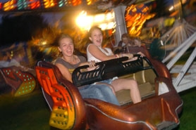 by: Vern Uyetake, Cassandra Wes, left, and Heather Hutson of Sherwood go for a spin at last year's Old Time Fair carnival. The fair kicks off its 50th year next weekend in Willamette.