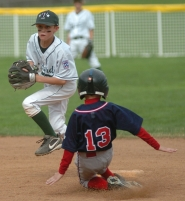 by: DAN BROOD, LOOKING TO TURN TWO — Tigard shortstop Joey Fishback (left) looks to make a throw to first after forcing out Beaverton's Nick Kristopherson at second base.