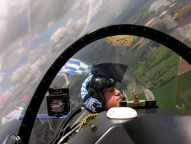 by: Submitted photo, Pilot Renny Price of Tualatin checks the view out the left side of his Sukhoi SU-29, a Russian-built, single-engine propeller plane. This will be his ninth year at the Oregon International Airshow.