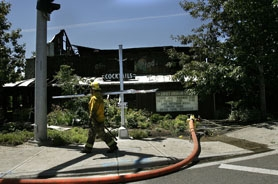 by: Jaime Valdez, Hillsboro firefighters kept watch in the afternoon July 7 to make certain the Sweet Oregon Grill fire didn't reignite.
