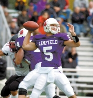 by: RYAN GARDNER, Brett Elliott set records at Linfield. Now he's out to prove he can make it in the NFL.