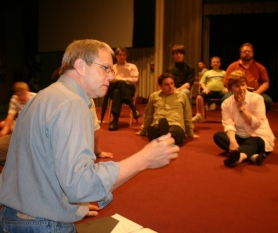 "by: Marcus Hathcock, Director Dennis Fitzpatrick gives the East Hill ""Our Town"" cast some words of wisdom before beginning the first act during a rehearsal Thursday evening. ""He embodies the spirit of 'Our Town,'"" says Artistic Director Jeff Schroeder."