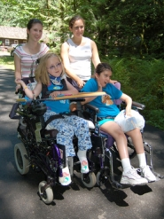 by: Barbara Adams, After lunch, MDA campers Michelle Pardo of Estacada, right, and her friend Emily go to a carnival sponsored by the Rotary Club at Camp Arrah Wanna in Welches.