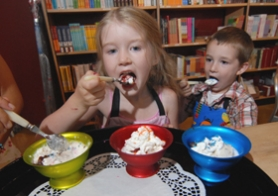 by: Vern Uyetake, Reed Chandler, 6, and her brother Robert Chandler, 4, try their ice cream creations at Sur La Table. The local store hosts birthday parties in their urban kitchen. Reed's pink poodle apron sells for $24.95 while Roberts washable bug apron is $17.95.