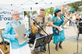by: John Klicker, From left, members of the Julie McCarl & Bodacious Toe Tappin' Groovy Gumbo band Julie McCarl, Rouke Van der Veen and Marvella McPartland entertain the crowd at the Gresham Art Walk, Saturday, July 15.
