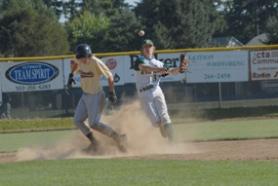 by: Vern Uyetake, West Linn infielder Ryan Barnes, top right, avoids an oncoming baserunner to compete a double play during the league baseball tournament this week in Canby. West Linn won that first-round game 13-0 over Milwaukie. Eliot Smith, left, closed out the victory on the mound.
