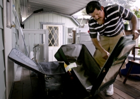 by: Jonathan House, Luis Diaz Sr. pulls luggage out onto the family's deck in preparation for his wife and two oldest children to pack up their belongings in the event they are forced to return to Guatemala.
