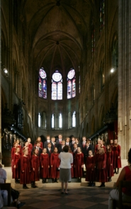 by: Submitted photo, Director Sandra Miller, front, leads the Oregon Youth Chorale as its members perform a song during a two-week tour through France recently.