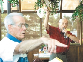 by: John Klicker, Don Balmer, right, calls for a show of hands as classmate John Welsh counts to see how fellow classmates have benefited from medical advances Friday, July 21.